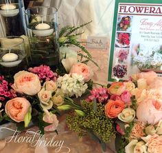 Candlight table arrangements with David Austin Juliet Roses. By 1800Flowers|Flowerama Iowa City