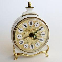Vintage 50s 60s Jerger West Germany Hollywood Regency White & Gold Bedside Table Alarm Clock. $44.00, via Etsy.