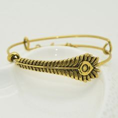 Looking for a symbolic gift? This Phoenix Feather Bangle Bracelet is what you're looking for! Phoenix burns itself to ash only to emerge from it's own ashes. Kinda like the symbol of infinity. You can also take it as a second chance at life. Perfect gift for your girlfriend or wife as a symbol of your infinite love. This gold bangle bracelet is great for summer, anniversary and really any occasions! Oh and did I mention harry potter?