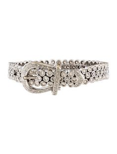 "18K white gold buckle bracelet featuring 12.00 carats of round brilliant diamonds and hinged clip closure. 0.86"" wide."