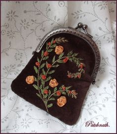 Black purse with ribbon embroidery