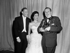 Walt Disney with his 4 Oscars with Elizabeth Taylor and her husband Michael Wilding - March 25, 1954 - In Walt's life-time he won or received 26 Oscars and holds the record for most Oscar wins still today.