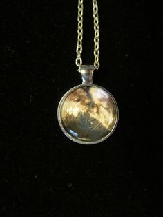 Kissing Otters Pendant Necklace or by EverythingsDuckyBout on Etsy, $9.99