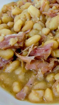 Slow Cooker Ham White Beans Served with crackers and sour cream made for a nice meal Pork Recipes, Slow Cooker Recipes, New Recipes, Dinner Recipes, Cooking Recipes, Favorite Recipes, Lima Bean Recipes, Hamburger Recipes, Slow Cooker Ham And Beans Recipe