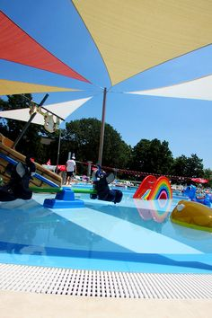 Solar canopies are really useful above kids' play areas. Also, you don't need to sacrifice style for functionality. With the proper colours, it can even add to a water park's design.  #solarcanopy #shadingdevices #waterpark