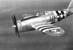 """Fighter P-47D «Thunderbolt"""" from the 63rd Air Force Squadron in flight over the English Channel"""