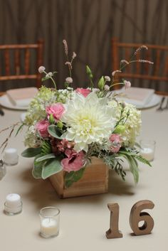 Summer centerpiece with blush lisianthus and white dahlias in a wooden box designed by Love 'n Fresh Flowers.