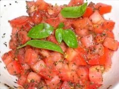 Bruschetta_My tomato plants are bursting with bright red juicy tomatoes, and I know just what I'm going to do with them...    Bruschetta is an all time favorite dish. You can serve it as an appetizer, or as a light lunch. By using fresh basil instead of dry, each bite will be so flavorful - not to mention having a wonderful fragrant aroma that can't be matched by using dry herbs.
