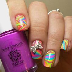 """Watermarble mani from @nails.in.arizona I'm loving that ring finger. """"First a full watermarble before I post the swatches starting tomorrow. I did this marble over a white base to really make them pop! I've had so much fun with these and can't wait to share my manis with you  I was inspired by@hospitalhandsand@stuckonlacquerfor this watermarble. Although mine pales in comparison!  I used all of the cremes in the@pure_poison_polishSpring Break Collection  and my bow charm…"""