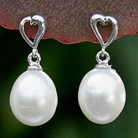 Filled with love, sterling hearts host luminous white pearls.   #earrings