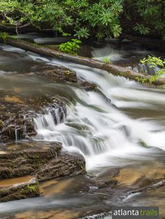Hike the Tumbling Waters Nature Trail to two waterfalls and a span bridge at Carters Lake