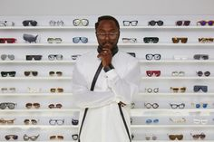 will.i.am​ striking a pose in front of his personal collection of frames, models a pair of specs from his new range #SpecsAppeal #celebrity #blackeyedpeas #music #william #specs #collection #eyewear #sunglasses #style #fashion #vogue #opticals
