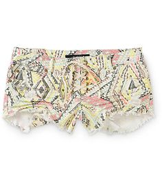 A colorful tribal print pattern covers these short shorts for a look that is sure to stand out, while the stretch denim constriction and lace up closure offer premium comfort.