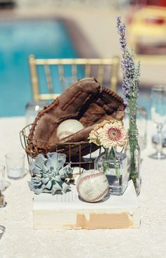 Baseball centerpiece. We used themes instead of table numbers.