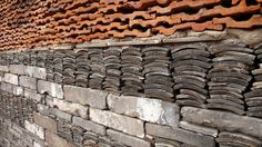 A detail of Wang Shu's wall of reclaimed materials in the Ningbo Museum. He used clay roofing tiles, bricks, stones, concrete, basically anything he could get his hands on.