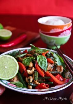 THAI BASIL CHICKEN WITH COCONUT RICE - 2 tbs kecap manis sweet soy sauce   2 tbs Thai fish sauce  1 tbs oyster sauce  1 tbs palm sugar, chopped finely   3-4 tbs oil  2 golden eschallots  2 cloves garlic  1/2 cup green onions  2 lge red chillies  500g chicken thighs  3/4 cup raw cashews  1 small red capsicum  150g green beans  1 whole bunch of Thai sweet basil or holy basil  Coconut Rice - 1 cup  jasmine rice  1 1/4 cups coconut cream  3 tbs desiccated coconut