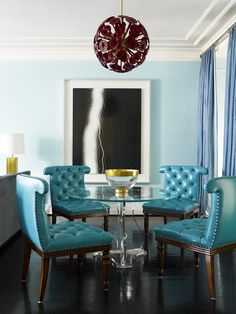 """I'm a huge fan of color! While deep and saturated, the blues here are calming, reminiscent of the sea off the coast of Majorca or Southern Italy. Aqua and turquoise can be airy and etheral but in this instance, dark wood floors, accents of brass, and the pop of the red Venetian chandelier ground the space, letting traditionally 'summery' colors work year round."" —Hillary Thomas"