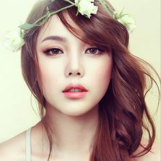 A slightly more dramatic look with a romantic feel - smokey copper eyes, peach lips and cheeks with contoured face.
