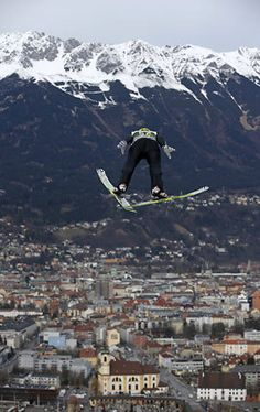 Finland's Janne Ahonen soars in front of the Wilten Basilica and the mountain Nordkette during his trial jump at the third stage of the four hills ski jumping tournament in Innsbruck, Austria, Friday, Jan. 3, 2014.