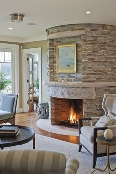 Love the stone around this curved fireplace!