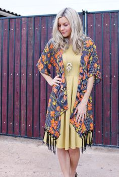 This LuLaRoe Monroe kimono is fabulous! So boho chic. Worn here with an Amelia dress. Click for more style ideas or to shop!