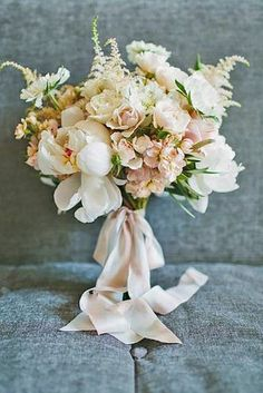 love this for me - but in my colors - more peach with peach ribbons! Something like this but smaller for my bridesmaids, one slightly larger than the rest for the maid of honor. The flowers I like are: peonies, magnolias, tinted hydrangea and the garden rose, and rannunculus.