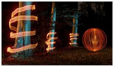 A Ball of light passing by three Light Painted Trees! Awesome light painting!