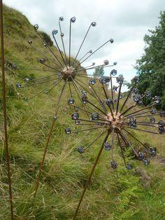 copper steel rods clad in copper glass garden or yard sculpture by artist lynn mahoney titled copper pod large big flower ffloral seed head garden