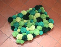 Multi-colour super soft non-slip Forest Canopy Pompom rug. Forest, Emerald, Spring and Grass green.
