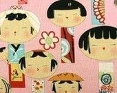 Yui Kokeshi Doll Fabric on Pink - By the Yard