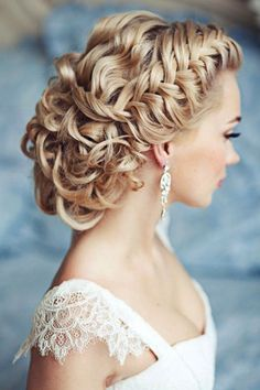 A bridal updo with eye-pleasing textures of curls brought together by a side braid. {Featured by: Elstile-spb}