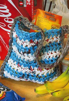 Don't we collect bags full of these things every month?  Crochet your plastic bags into a, what else... a plastic bag tote. crafts-n-things-recycled-plastic-bag-tote
