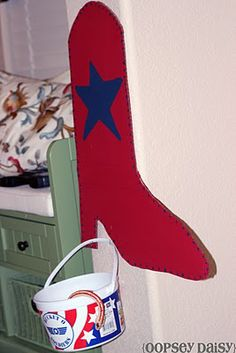 Toy Story Party- banner, snake in the boot game, and pin the star on woody game.