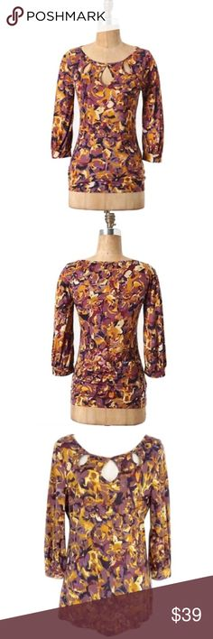 """❗️FINAL❗️POSTMARK Teardrop Cutout Floral Shirt 🔸POSTMARK Anthro S Traced Teardrop Cutout Floral Top NWOT🔸Size Small🔸Multi colored🔸Floral print🔸3 teardrop cutouts on neckline🔸3/4 sleeve with banded cuffs🔸Smooth jersey knit material🔸90% Tencel 10% Wool🔸Bust 32-34-slight stretch🔸Length approx. 25 1/2""""🔸Semi sheer🔸Beautiful vibrant colors🔸NWOT Anthropologie Tops Blouses"""
