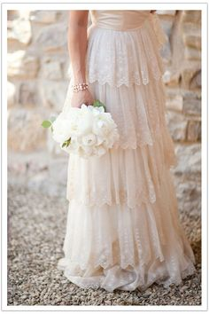 Beautiful lace tiered wedding dress. Found on hoop skirts and corsets #dresses