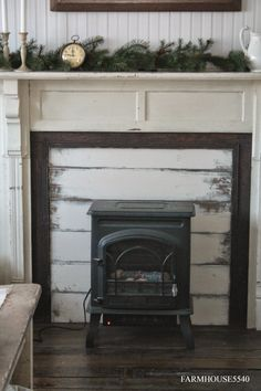 This is a ceramic radiator style electric heater. I LOVE it & it would be perfect for downstairs. Also like idea of putting wood across insert of fireplace (keeps drafts out) Faux Fireplace Mantels, Stove Fireplace, Fireplace Surrounds, Fireplaces, Mantles, Fireplace Space Heater, Fireplace Ideas, Electric Wood Stove, Electric Fireplace
