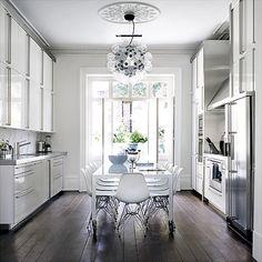 Gorgeous white kitchen with wood floors!