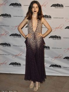 Taking the plunge: The actress, 28, looked every inch of glamour in her dramatic purple go...