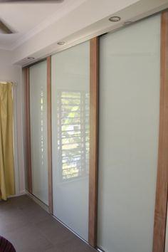 Infinity Sliding Doors using Limed Tassie Oak and white glass inserts