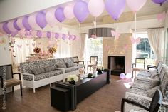 party room decorated with balloons with strings of butterflies