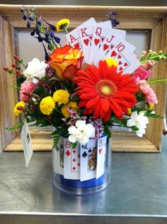 Themed arrangement for casino night! incorporating the theme of your event into the flowers to make the decorative elements pop! via brownf… Casino Party, Las Vegas Party, Casino Theme Parties, Casino Wedding, Game Night Parties, Poker Party, Mad Hatter Tea, Brown Floral, Party Time