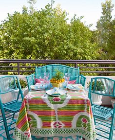 Love the brightly painted turquoise, stick, wicker furniture!