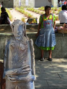 Alejandro Santiago's 2501 Imigrantes lines the streets and sits in front of Santo Domino, Oaxaca, Mexico