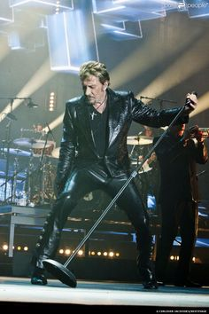 Johnny Hallyday in concert in Montpellier on May - Johnny Haliday, Mens Leather Pants, Laetitia, Christian Audigier, Christian Families, Concert, Music Artists, Rock N Roll, Photo S