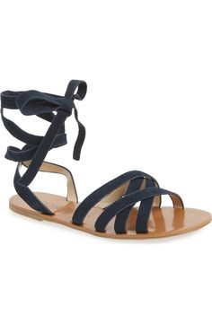This versatile open-toe sandal features four straps that crisscross at the instep and two straps that wind around the ankle to finish in a bow. So cute!