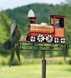 My boy would love this train whirligig.  Lots of other cool ones at Plow & Hearth.