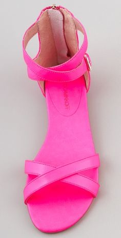 """""""I'm definitely not one of those New York City girls who lives in black. I need to spice up my day (and my wardrobe) with at least one bright accessory to complete my outfits. These pink sandals would be a nice contrast to a toenail polish in a bright shade like lavender or orange."""" -Felicia from Random House"""
