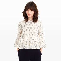 Peibi Top - Made from a lightweight cotton and finished with pretty, textured clip dot details and generous ruffles at the hem and cuffs, our Peibi top imparts a sweet sensibility to everything from trousers to denim.