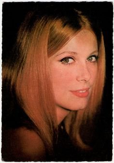 Catherine Deneuve with red hair - very charming!