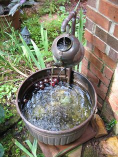Tea Pot water fountain! Must figure out a way to put this in my garden. I adore the sound of running water in a garden and this is so simple and fantastic!